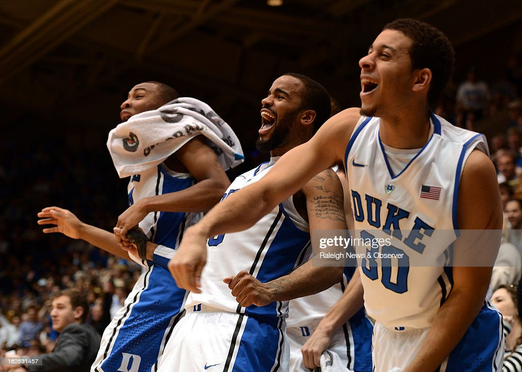 Duke players guard Rasheed Sulaimon (14), forward Josh Hairston (15) and guard Seth Curry (30) react as a teammate steals the ball in the final seconds of the game against Boston College at Cameron Indoor Stadium in Durham, North Carolina, Sunday, February 24, 2013. Duke defeated Boston College, 89-68.
