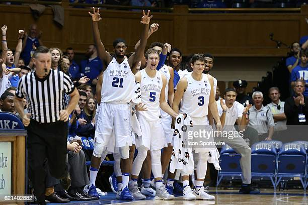 Duke players including Amile Jefferson Luke Kennard and Grayson Allen reacts to a three point basket by a teammate The Duke University Blue Devils...