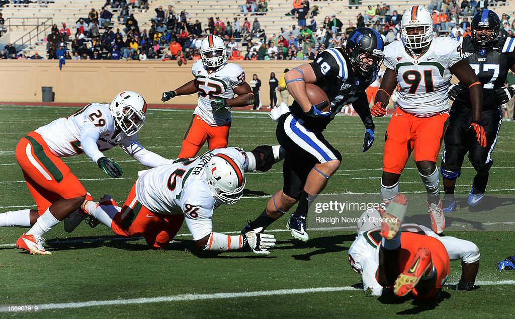 Duke quarterback Brandon Connette (18) turns a broken play into a first-half touchdown against Miami at Wallace Wade Stadium on Saturday, November 24, 2012, in Durham, North Carolina. The Miami Hurricanes defeated the Duke Blue Devils, 52-45.