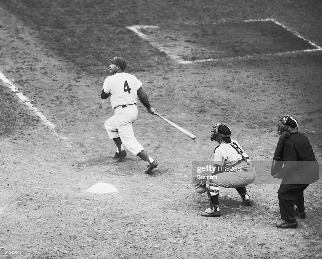 <a gi-track='captionPersonalityLinkClicked' href=/galleries/search?phrase=Duke+Snider&family=editorial&specificpeople=93319 ng-click='$event.stopPropagation()'>Duke Snider</a>, Dodgers, doubles to left field in 7th inning of fifth game of the World Series. Berra is the catcher and Bill Summers is the umpire.