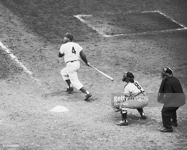 Duke Snider Dodgers doubles to left field in 7th inning of fifth game of the World Series Berra is the catcher and Bill Summers is the umpire