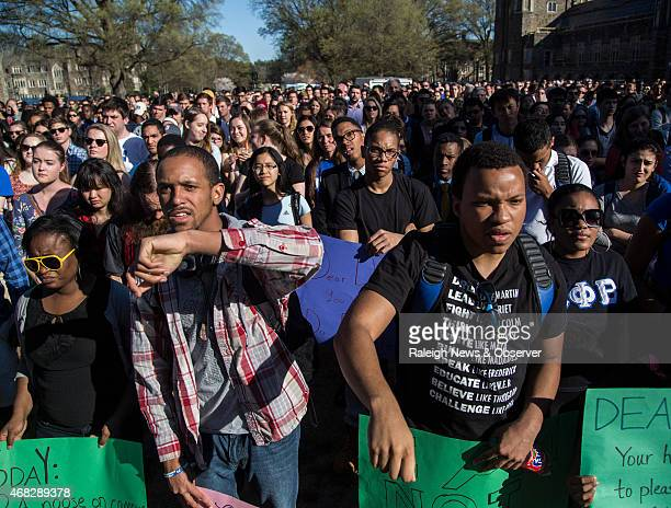 Duke students Ashton Pemberton left and Denzel Caldwell rally with hundreds during a universitywide forum Wednesday April 1 outside Duke Chapel on...