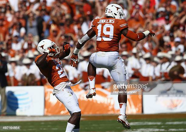 Duke Thomas of the Texas Longhorns and Peter Jinkens celebrate a play against the Oklahoma Sooners during the 2015 ATT Red River Showdown at Cotton...