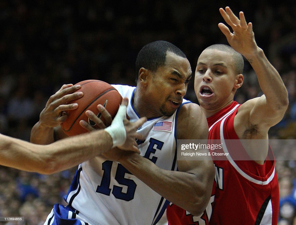 Duke's Gerald Henderson (15) moves in past Davidson guard Stephen Curry (30) in the first half at Cameron Indoor Stadium in Durham, North Carolina, Wednesday, January 7, 2009.