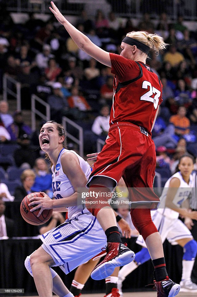 Duke's' Haley Peters, left, looks to the basket around Nebraska's Emily Cady during Sunday's NCAA women's basketball regional semifinal on March 31, 2013, at the Ted Constant Center in Norfolk, Virginia. Duke won, 53-45.