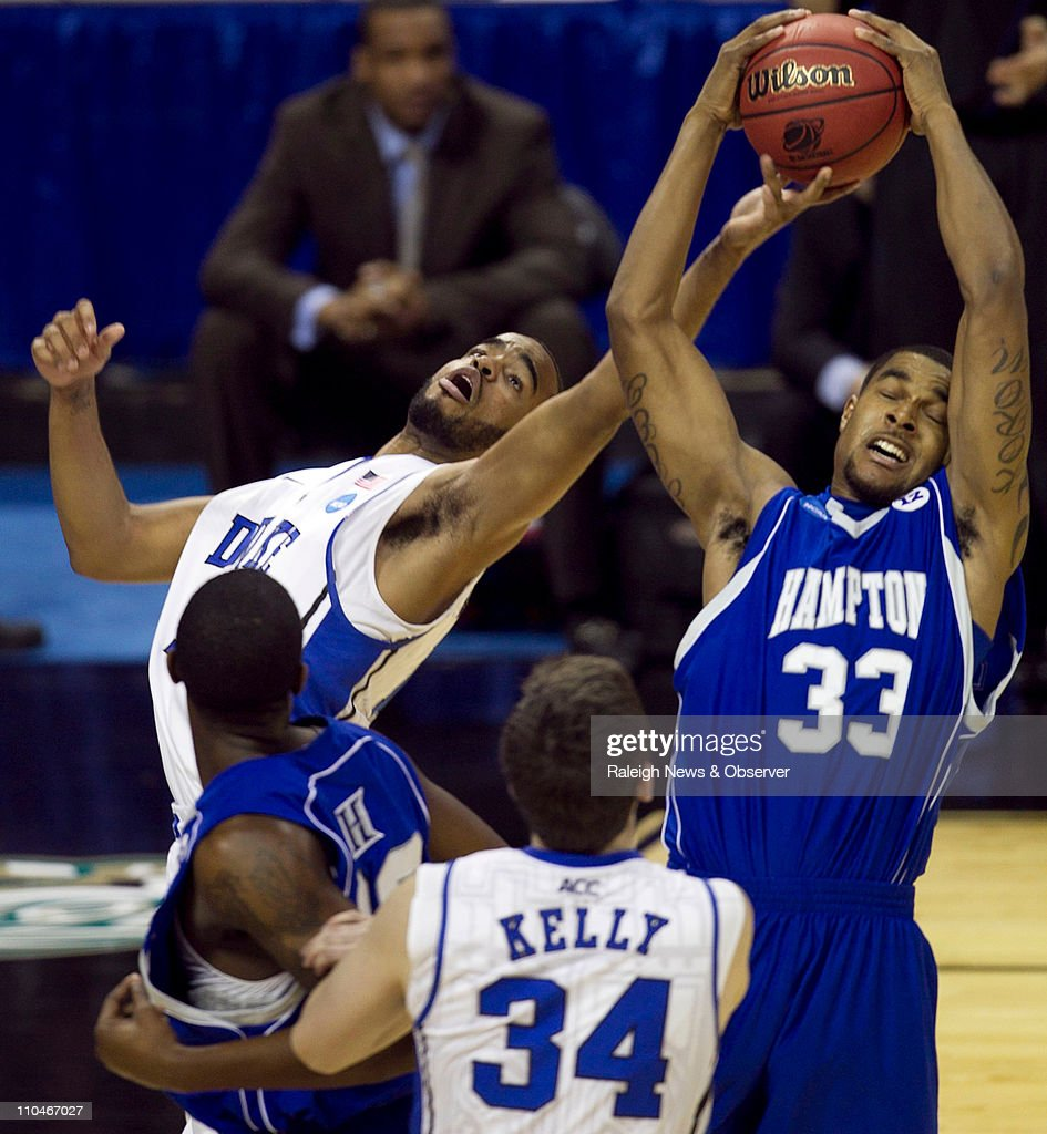 Duke's Josh Hairston (15) battles for a rebound with Hampton's Korn Reed (33) during the second half of a second-round game in the 2011 NCAA Men's Basketball Championship at Time Warner Cable Arena in Charlotte, North Carolina, Friday, March 18, 2011. Duke beat Hampton, 87-45.