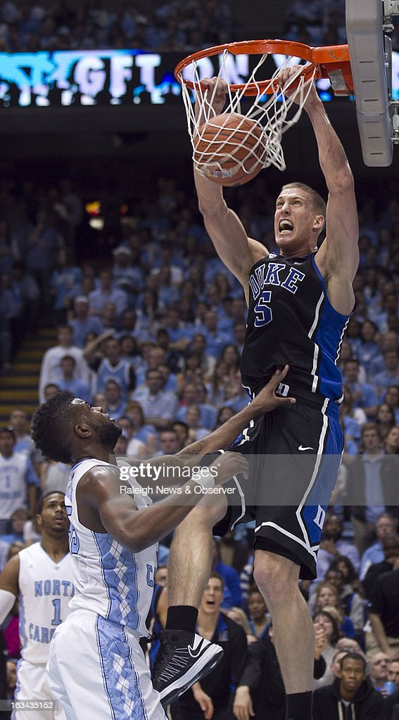 Duke's Mason Plumlee (5) dunks over over North Carolina's Reggie Bullock (35) in the second half on Saturday, March 9, 2013, at the Smith Center in Chapel Hill, North Carolina. Duke topped the Tar Heels, 69-53.