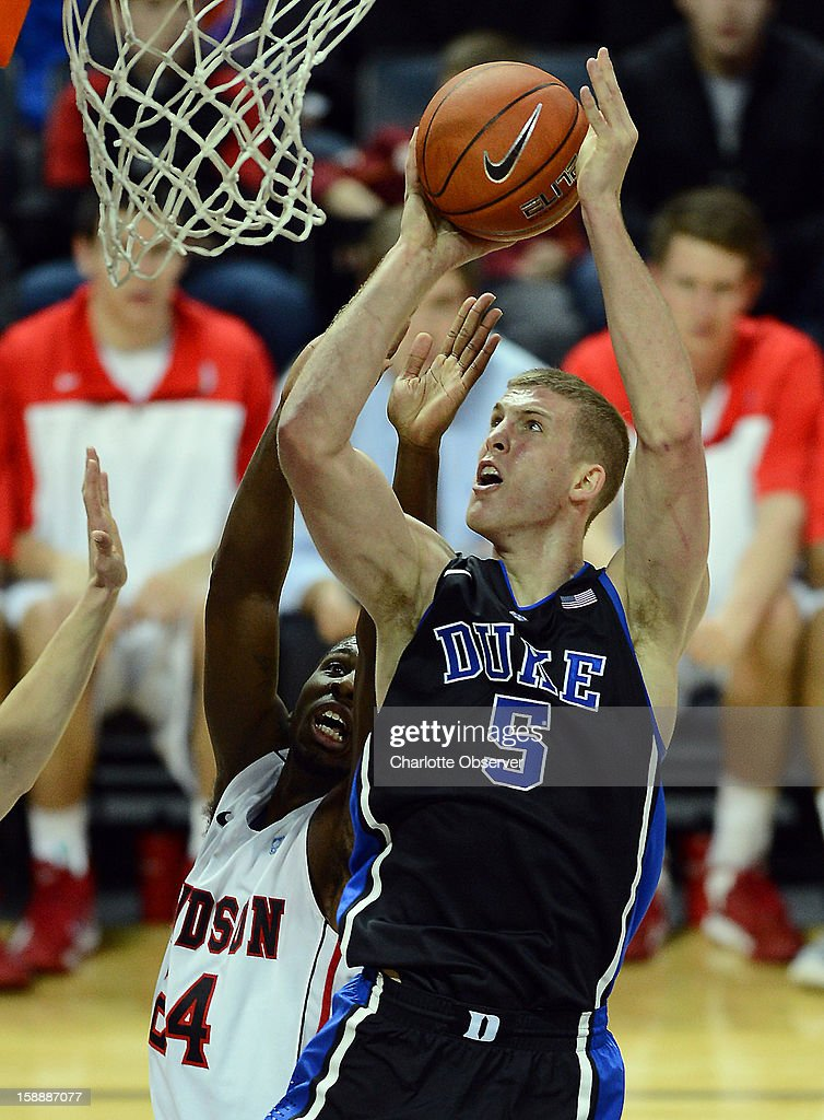 Duke's (5) Mason Plumlee fights his way to the basket for two points as Davidson's (24) De'Mon Brooks applies defensive pressure during first-half action at Time Warner Arena in Charlotte, North Carolina, on Wednesday January 2, 2013.