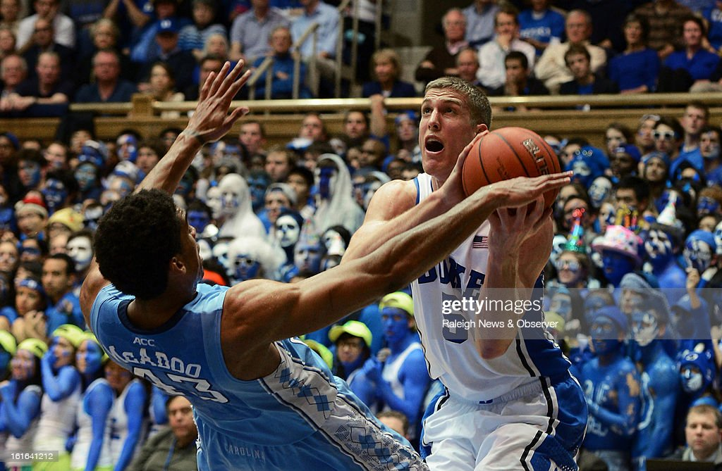 Duke's Mason Plumlee (5) goes in for a shot as North Carolina's James Michael McAdoo (43) tries to draw a foul at Cameron Indoor Stadium in Durham, North Carolina on Wednesday, February 13, 2013.