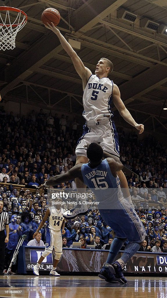 Duke's Mason Plumlee (5) is fouled by North Carolina's P.J. Hairston (15) as he goes in for two of his 18 game-high points at Cameron Indoor Stadium in Durham, North Carolina, on Wednesday, February 13, 2013. Duke edged North Carolina, 73-68.