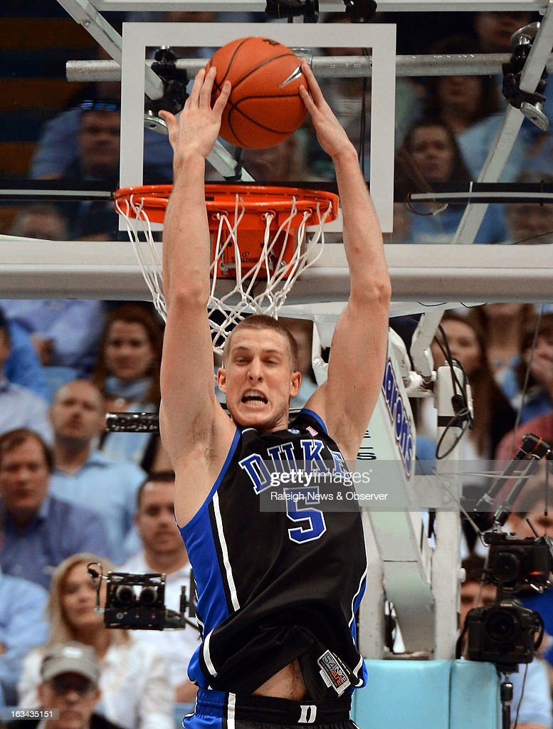 Duke's Mason Plumlee (5) jams a reverse dunk in the second half against North Carolina on Saturday, March 9, 2013, at the Smith Center in Chapel Hill, North Carolina. Duke topped the Tar Heels, 69-53.