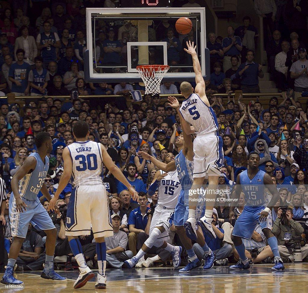 Duke's Mason Plumlee (5) puts up a hook shover North Carolina's James Michael McAdoo (43) in the second half at Cameron Indoor Stadium in Durham, North Carolina, on Wednesday, February 13, 2013. Duke edged North Carolina, 73-68.