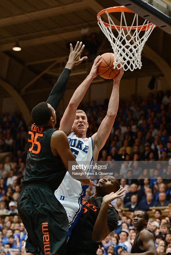 Duke's Mason Plumlee shoots as Miami's Kenny Kadji (35) and Reggie Johnson, right, defend in the first half at Cameron Indoor Stadium in Durham, North Carolina, on Saturday, March 2, 2013.