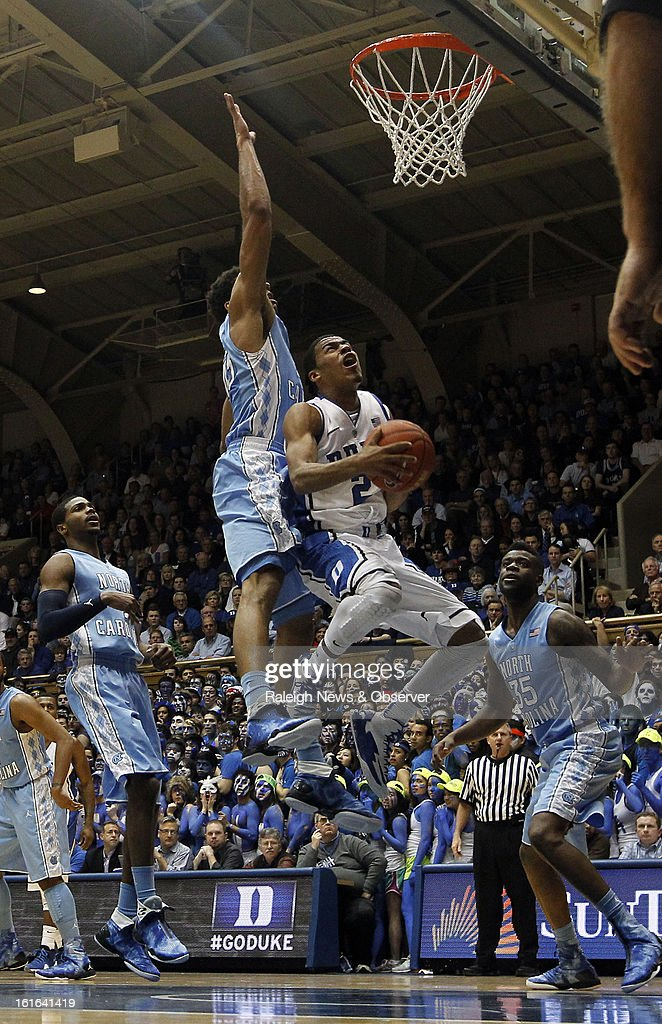 Duke's Quinn Cook (2) attempts a first-half shot as North Carolina's James Michael McAdoo (43) defends at Cameron Indoor Stadium in Durham, North Carolina, on Wednesday, February 13, 2013.