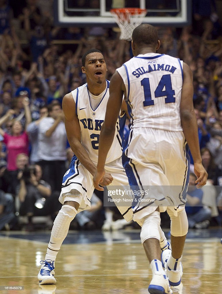 Duke's Quinn Cook (2) celebrates with teammate Rasheed Sulaimon (14) after Sulaimon sank a 3-point shot in the second half to help secure a 73-68 win over North Carolina at Cameron Indoor Stadium in Durham, North Carolina, on Wednesday, February 13, 2013.