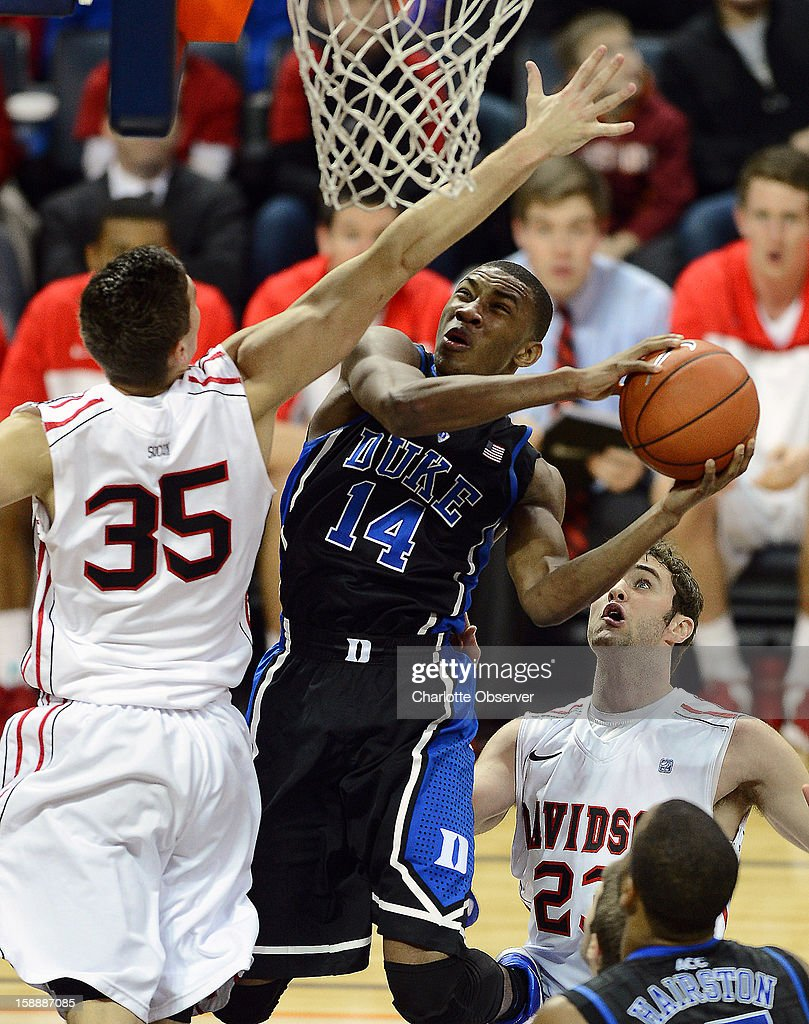 Duke's Rasheed Sulaimon (14) drives to the basket as Davidson's Chris Czerapowicz (35) applies defensive pressure during first-half action at Time Warner Arena in Charlotte, North Carolina, on Wednesday January 2, 2013.
