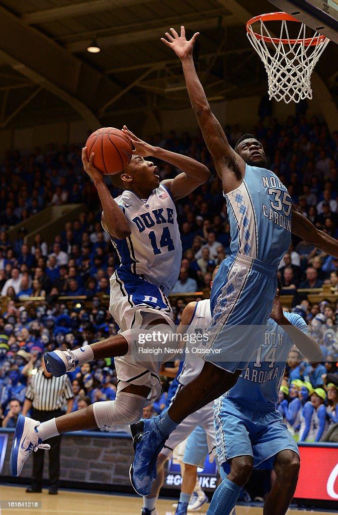 Duke's Rasheed Sulaimon (14) goes inthe lane against North Carolina Reggie Bullock (35) in the first half at Cameron Indoor Stadium in Durham, North Carolina on Wednesday, February 13, 2013.