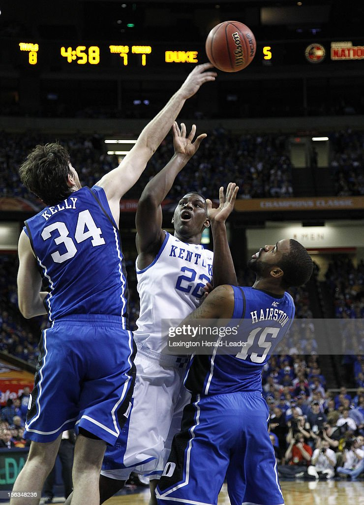 Duke's Ryan Kelly (34) blocks the shot of Kentucky's Alex Poythress (22) in the first half in the State Farm Champions Classic on Tuesday, November 13, 2012, at the Georgia Dome in Atlanta, Georgia.