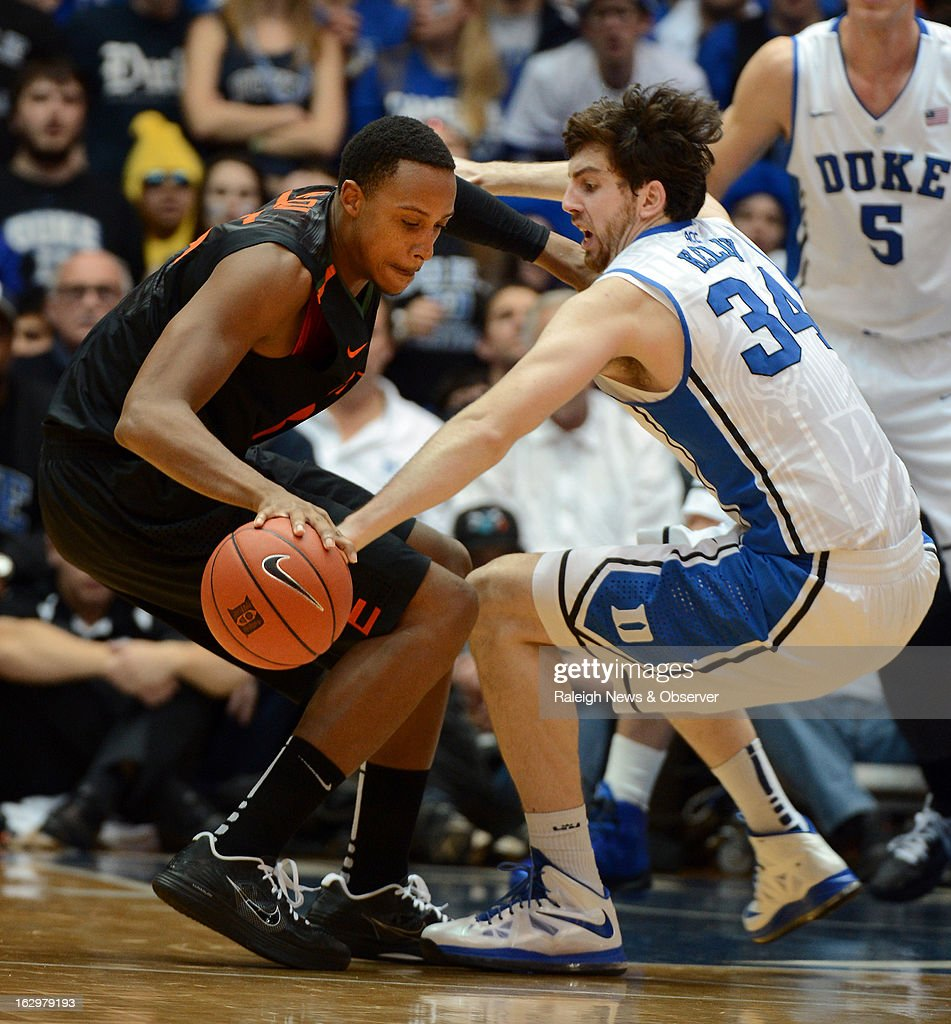 Duke's Ryan Kelly (34) defends as Miami's Kenny Kadji tries to move the ball inside in the first half at Cameron Indoor Stadium in Durham, North Carolina, on Saturday, March 2, 2013. Duke held off Miami, 79-76.