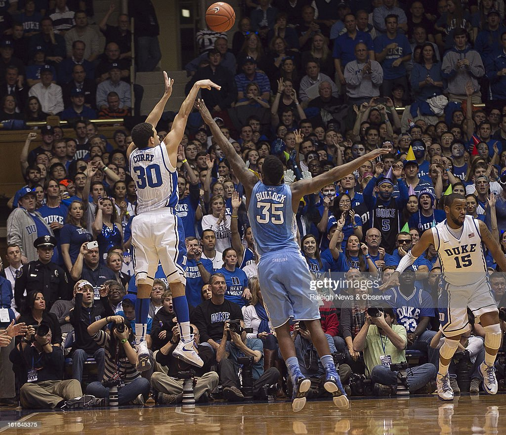 Duke's Seth Curry (30) launches a 3-point shot over North Carolina's Reggie Bullock (35) in the second half at Cameron Indoor Stadium in Durham, North Carolina, on Wednesday, February 13, 2013. Duke edged North Carolina, 73-68.