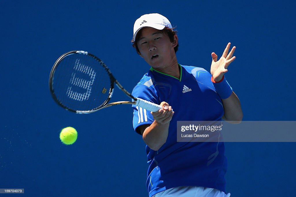 Duk-Young Kim of Korea plays a forehand in his first round match against Mackenzie McDonald of the United States of America during the 2013 Australian Open Junior Championships at Melbourne Park on January 19, 2013 in Melbourne, Australia.