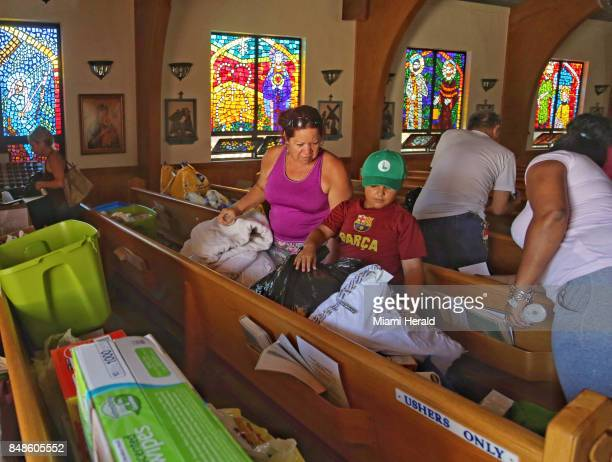 Dulce Carvajal left and Dairon Esposito center both neighbors along with other Marathon residents search through donated items A mass held for about...