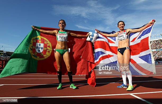 Dulce Felix of Portugal celebrates gold and Jo Pavey of Great Britain the silver in the Women's 10000 Metres Final during day five of the 21st...