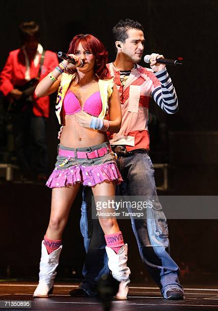 Dulce Maria Espinoza Savinon and Alfonso Herrera Rodriguez of the group RBD perform at American Airlines Arena on July 1 2006 in Miami Florida