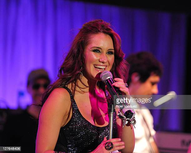 Dulce Maria performs at a LA exclusive concert for Time Warner Cable at the The Highlands Club in the Hollywood Highland Center on April 2 2011 in...