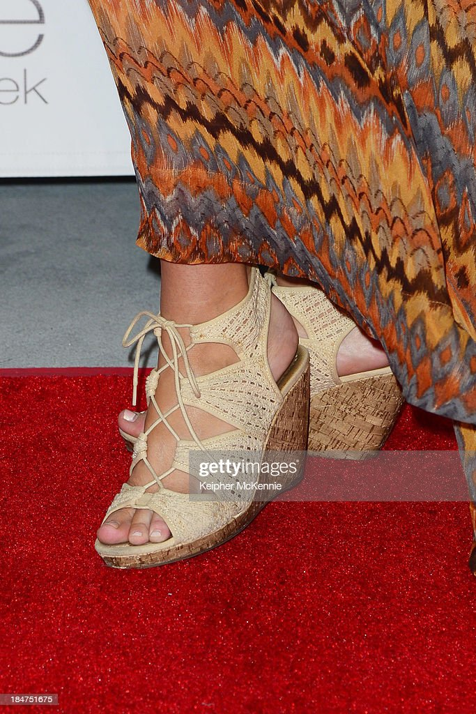 Dulcenea lingerie model Samantha Siong (shoe detail) arrives to Day By Day Clothing Spring 2014 Collection Fashion Show at L.A. Live Event Deck on October 15, 2013 in Los Angeles, California.