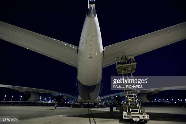 Maintenance mechanics check the hortizontal stabilizer area of an Airbus 380 the new doubledecker 555 passenger jet as it sits on the tarmac before...