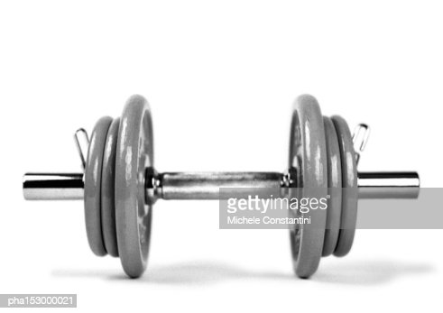 Dumbbell and weights, b&w.