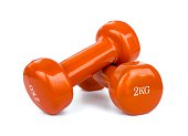 Orange dumbbell weights isolated on white