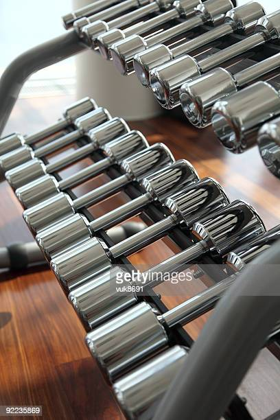 Dumbbells in fitness center