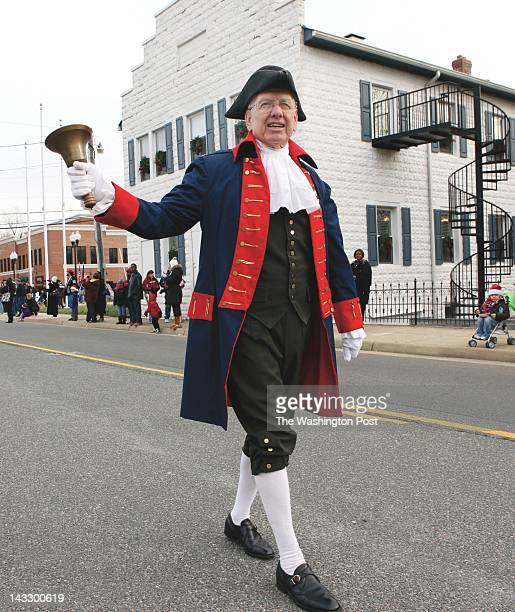 Dumfries holds its 36th annual holiday parade December 11 2010 in Dumfries Va Town Crier Gary West rings bell as he lead parade down Main street The...