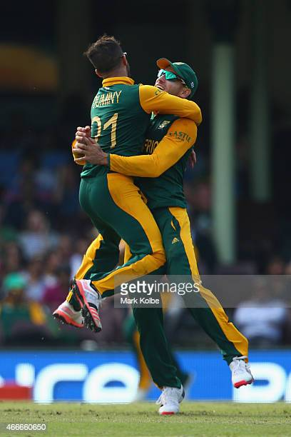 Duminy and Faf du Plessis of South Africa celebrates combining to take the wicket of Angelo Mathews of Sri Lanka during the 2015 ICC Cricket World...