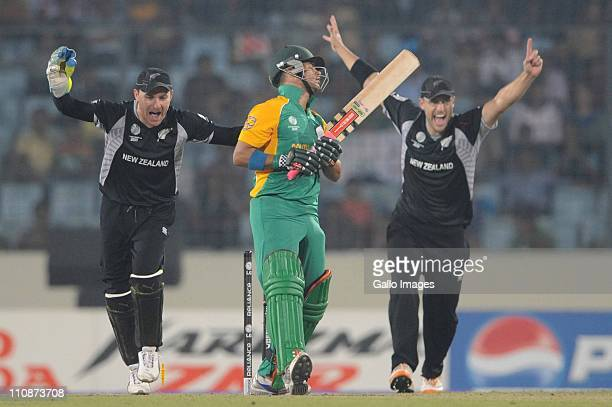 Duminy of South Africa bowled by Nathan McCullum of New Zealand during the ICC Cricket World Cup Quarter Final match between South Africa and New...