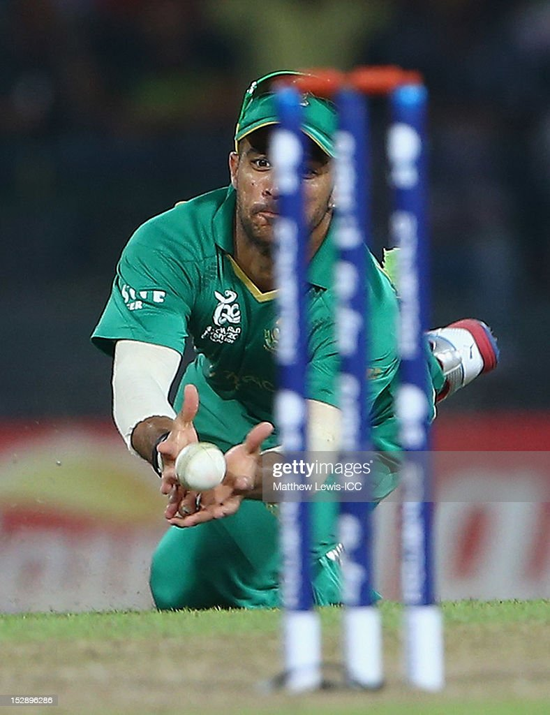 <a gi-track='captionPersonalityLinkClicked' href=/galleries/search?phrase=JP+Duminy&family=editorial&specificpeople=3640895 ng-click='$event.stopPropagation()'>JP Duminy</a> of South Africa catches Yasir Arafat of Pakistan during the ICC World Twenty20 2012 Super Eights Group 2 match between Pakistan and South Africa at R. Premadasa Stadium on September 28, 2012 in Colombo, Sri Lanka.