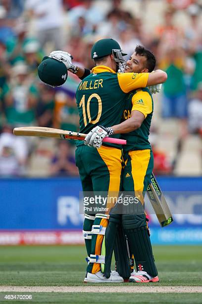 Duminy of South Africa celebrates his century with David Miller during the 2015 ICC Cricket World Cup match between South Africa and Zimbabwe at...