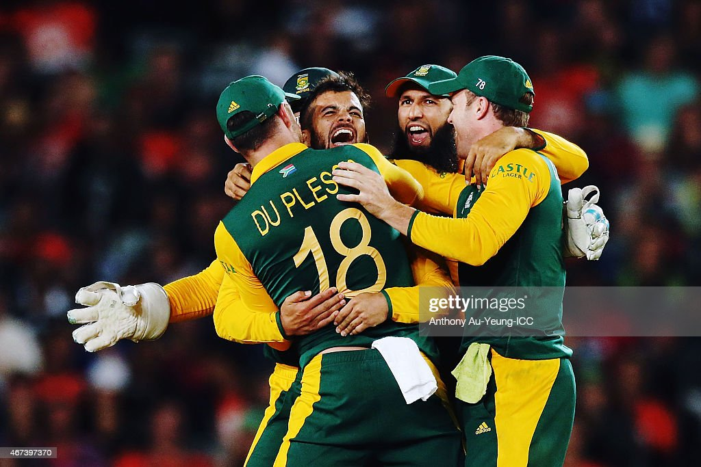 JP Duminy of South Africa celebtrates with the team after getting the wicket of Ross Taylor of New Zealand during the 2015 Cricket World Cup Semi Final match between New Zealand and South Africa at Eden Park on March 24, 2015 in Auckland, New Zealand.