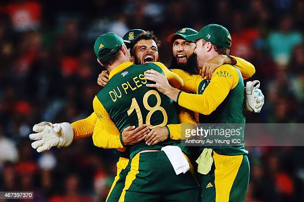 Duminy of South Africa celebtrates with the team after getting the wicket of Ross Taylor of New Zealand during the 2015 Cricket World Cup Semi Final...