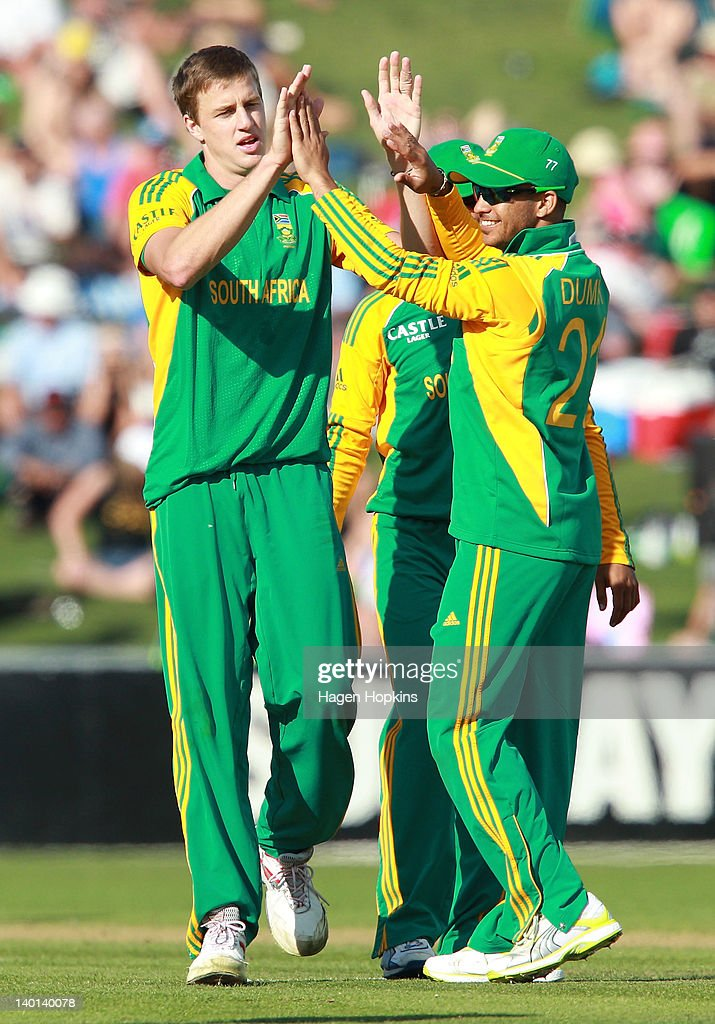 JP Duminy (R) of South Africa congratulates teammate Morne Morkel on the wicket of Tarun Nethula of New Zealand during the One Day International match between New Zealand and South Africa at McLean Park on February 29, 2012 in Napier, New Zealand.