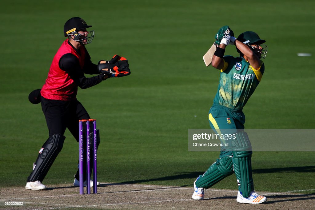 JP Duminy of South Africa hits out while Sussex wicket keeper Michael Burgess looks on during the Tour Match between Sussex and South Africa at The 1st Central County Ground on May 19, 2017 in Hove, England.