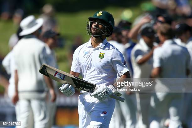 Duminy of South Africa leaves the field after being dismissed during day two of the test match between New Zealand and South Africa at Basin Reserve...