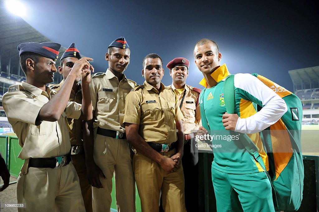 <a gi-track='captionPersonalityLinkClicked' href=/galleries/search?phrase=JP+Duminy&family=editorial&specificpeople=3640895 ng-click='$event.stopPropagation()'>JP Duminy</a> of South Africa poses for a photograph with security guards during a Proteas nets session at VCA Stadium on March 11, 2011 in Nagpur, India.