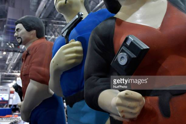 Dummies on holding a photo camera on display as at a law enforcement expo part of the annual International Association of Chiefs of Police conference...