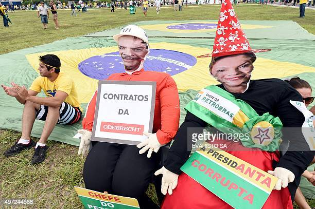 Dummies representing Brazilian President Dilma Rousseff and former president Luiz Inacio Lula da Silva are displayed during a demonstration calling...