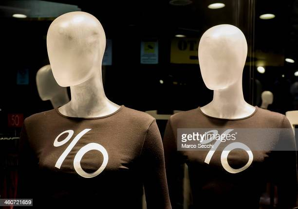 Dummies showing the % sign for the sales are on display in a city centre shop on January 5 2014 in Venice Italy Sales got off to a slow start in...
