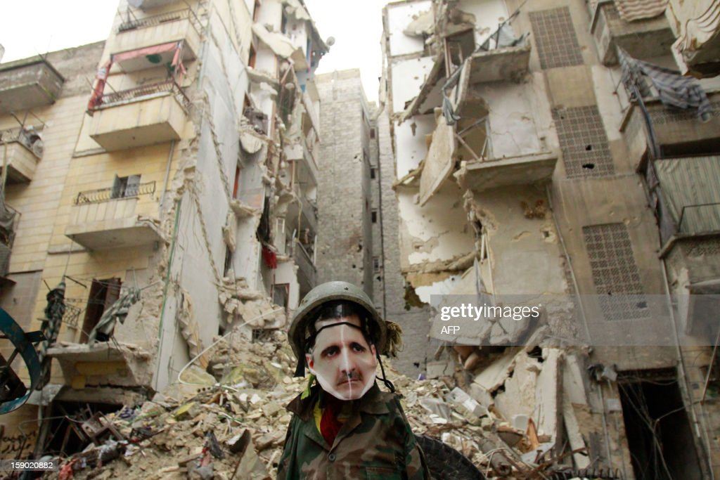 A dummy dressed up in army fatigue and a mask depicting Syrian President Bashar al-Assad is erected in the Salaheddine neighbourhood of Aleppo, the scene of heavy fighting on January 5, 2013. Saudi Arabia and Egypt called for a peaceful solution to the conflict roiling Syria, but said the terms of a settlement to end the bloodshed there must be defined by the Syrian people.