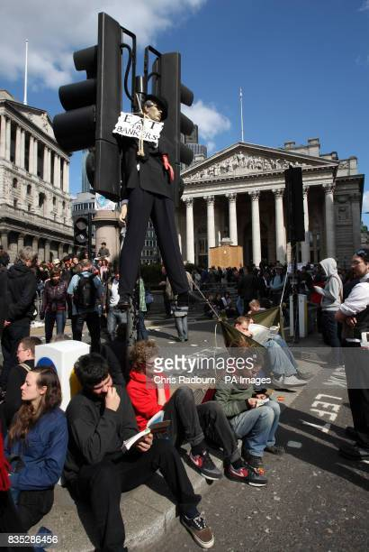 A dummy of a Banker hangs from a traffic light outside the Bank of England during the G20 protests in the centre of London